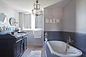Vintage-style washstand in elegant bathroom in shades of grey