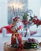 Chocolate Father Christmas decorated with sparklers