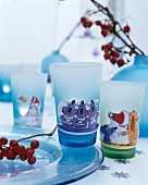 Drinking glasses with wintry cartoon motifs
