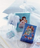 Presents wrapped in blue paper decorated with scrapbook angels and French wire