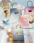 Small paper gift bags decorated with gold crowns