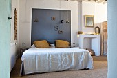 Bedroom with headboard panel in contrasting colour on wall