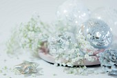 Silver baubles and gypsophila on plate