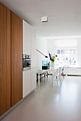 White floor and dining table in minimalist kitchen