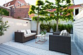 Lounge furniture in seating area of modern courtyard garden