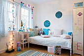 Teenager's bedroom festively decorated in pastel shades