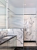 Elegant marble bathroom with shower area