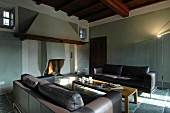 Lounge area with open fireplace in renovated country house