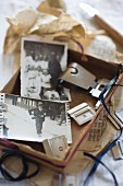 Open box of vintage photos and alphabetic labels