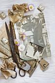 Vintage arrangement of daisies, vintage scissors, metal clips and old photos