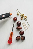 Natural craft materials, horse chestnuts, toothpicks and bradawl
