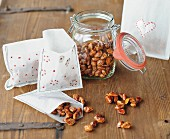 Candies almonds in preserving jar and in hand-made gift bags