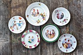 Hand-made decorative wall plates with pictures of women in traditional costume and flowers