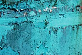 Peeling blue paint on a wall