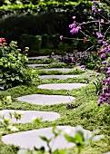 Garden path made of ingrown tread plates