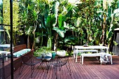 Wooden terrace in a tropical ambience with various outdoor furniture