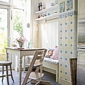 High chair, traditional bench in niche and vintage-style kitchen table