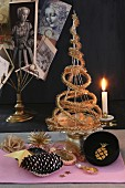 Original Christmas tree made from gold tinsel on cake stand with candle holder