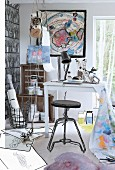 Outlines drawn on photo of black stool, white table and various sketches on floor