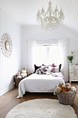 Wood-clad girl's bedroom with collection of soft toys on bed and in wicker baskets