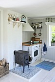 Rustic kitchen with black, cast iron stove and cooker
