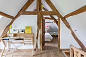 Study area in converted attic with exposed, old half-timbered structure