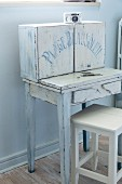 Shabby-chic fold-out writing desk with cupboards on top