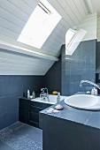 Two-tone attic bedroom with masonry tub