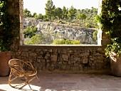 Wicker chair on Mediterranean veranda with a view