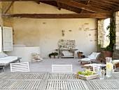 Long tableon roofed Mediterranean terrace