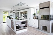 Free-standing counter in white designer kitchen