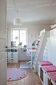 Desk and loft bed in pretty bedroom