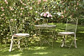 Romantic retreat in flowering rose garden