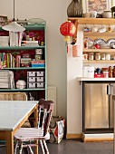 Eclectic ambiance in kitchen-dining area with lanterns and kitchen chair