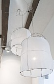 Pendant lamps with fabric lampshades on wire frames