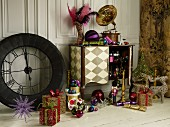 Wrapped gifts and Christmas decorations around vintage clock and postmodern console table