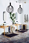 Bathroom in ethnic style with filigree vanity furniture, floor vase and black pendant lights