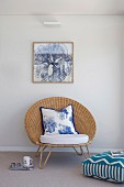 Elegant 'papas armchair' with seat cushion and cushion under a framed picture