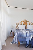 Double bed with bedspread and handcrafted bed rattan headboard