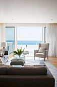 Elegant living area with open sliding patio doors, balcony and sea view