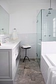 Bathroom with glass shower cabin and vanity furniture in country style