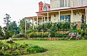 House with surrounding veranda and front garden