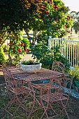 Garden furniture made of metal in the summer garden