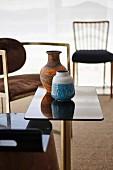 Ceramic vase on black glossy side table