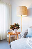 Floor lamp next to the side table and basket in the corner of the room with retro flair