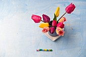 Spring arrangement of tulips and 'Springtime' written in small letter blocks