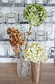 Dried hydrangeas in front of bottle-drying rack