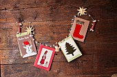 Hand-made Christmas cards with various motifs on rustic wooden surface