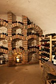 Masonry wine rack and wooden wine rack in wine cellar