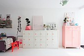 Pink and white furniture in open-plan interior